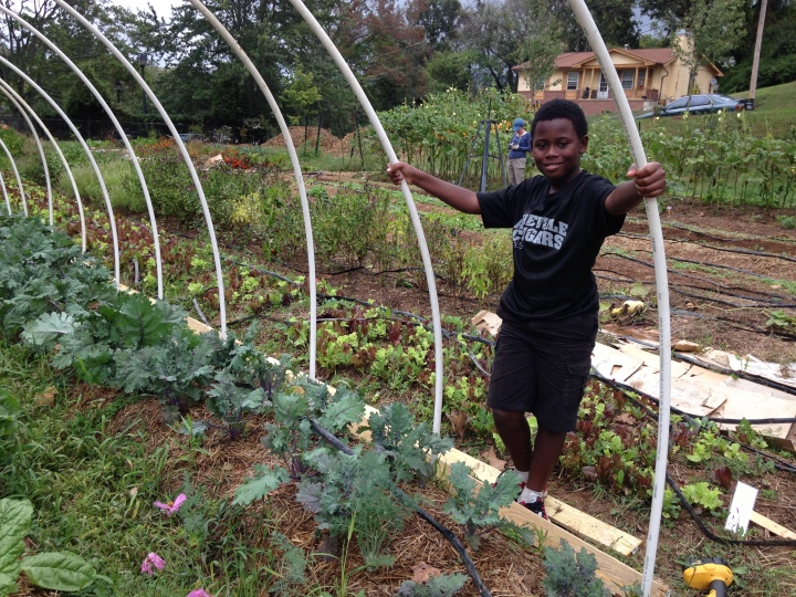 Young man in the Southside Community Garden, a space for community action and transformation.