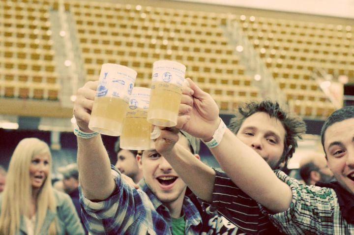 Young white men drinking beer, photo by Crystal Anderson